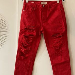 Lucky Brand red cropped distressed look jeans.